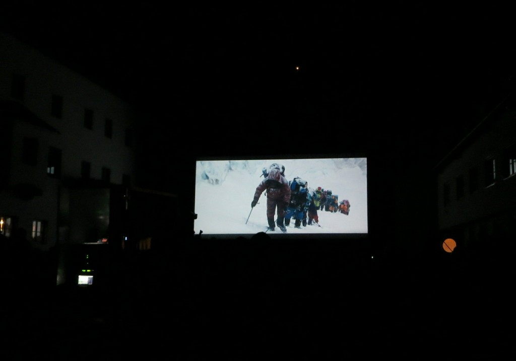 Outdoor screening of Everest in the village square. (Credit: I. Nias)