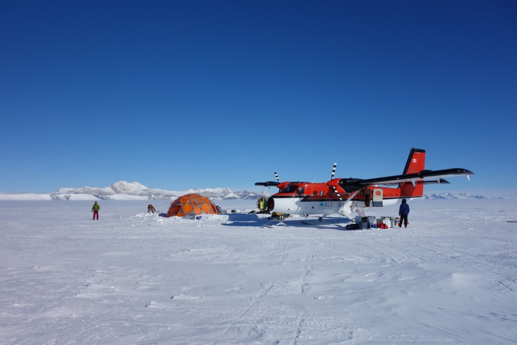 Quickly packing up our camp because the Twin Otter has just arrived to take us back to Union Glacier base. (Credit: H. Millman)