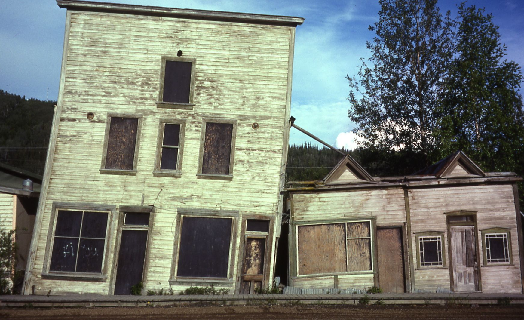An old building in Dawson, Yukon, warped by thawing permafrost. Photo credit: Antoni Lewkowicz