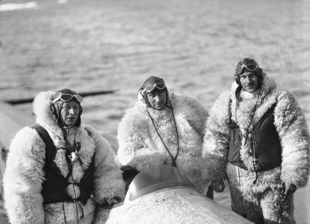 Danish expeditioner Lauge Koch, centre, along with his pilots all dressed in suits made from polar bear. (Credit: The Arctic Institute)