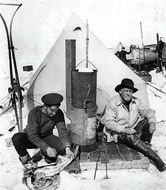 Frank Hurley and Ernest Shackleton at camp, first published in the United States in Ernest Shackleton's book, South, in 1919., via Wikimedia Commons
