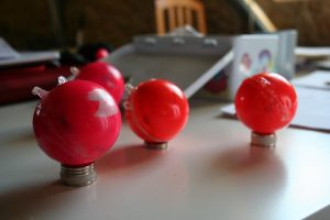 The ETracers stacked on small magnets. This temporarily stops their bleeps [Credit: E. Bagshaw].