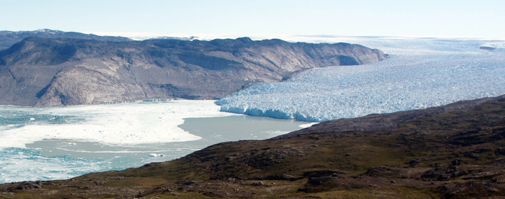 Figure 2: Kangiata Nunata Sermia, a large tidewater glacier in south-west Greenland. The expression of a plume originating at the base of the calving front is visible on the fjord surface as turbid sediment-rich water. [Credit: Peter Nienow]