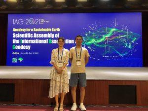 Zhen Li and his colleague Qianqian Li at the IAG scientific assembly in Beijing.