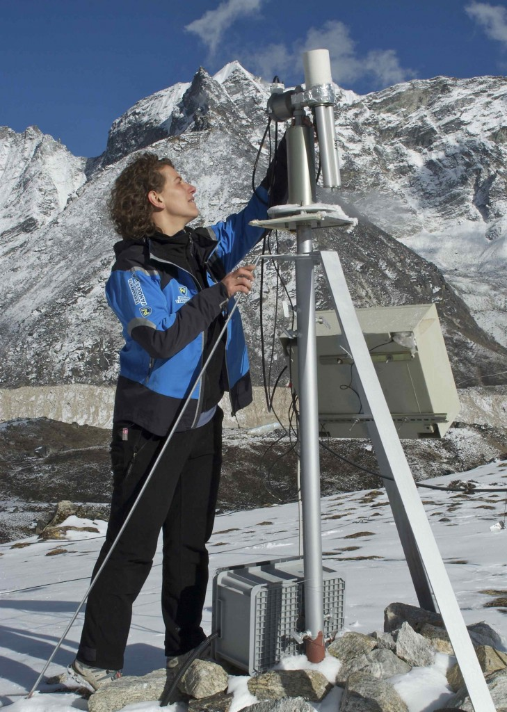 Angela Marinoni adjusting a sun photometer for measuring aerosols. (Credit: Jane Qiu)