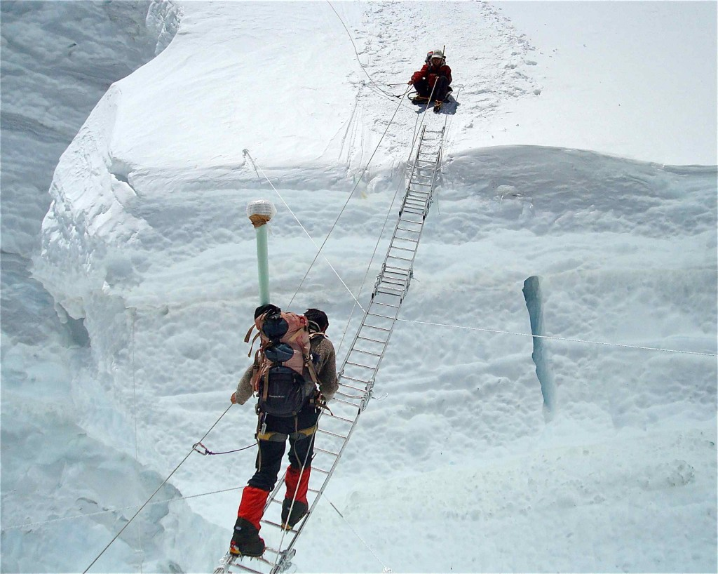 Pemba Wangchu traversing a ladder in the Khumbu Icefall, while Pema Sherpa had crossed safely. They were part of an expedition team to install a weather station at the South Col at 8,000 metres above sea level. (Credit: SHARE Everest Expedition)