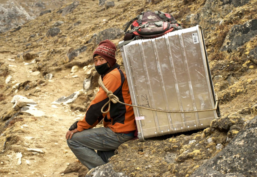 A Nepalese porter carrying new scientific equipment to the Pyramid.