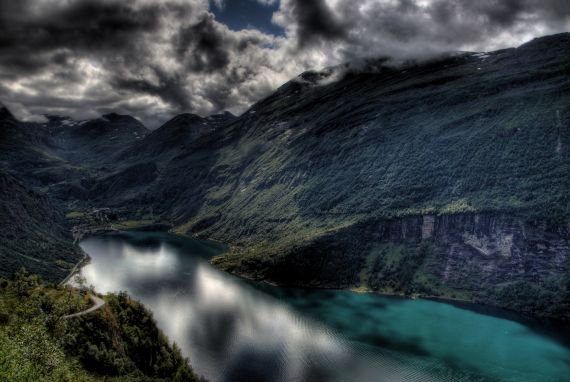 """""""Storm at Geiranger"""" by Philippe Chambon, distributed by the EGU under a Creative Commons licence. Geirangerfjord is among the world's longest and deepest fjords, with water reaching depths of 500 metres and channel walls reaching over 1 kilometre in height."""