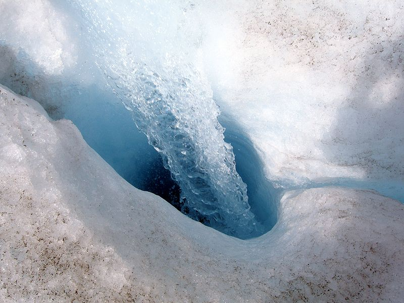 Surface water entering a moulin on Athabasca Glacier (a much smaller Moulin than the one what would have drained the Greenland lake). (Credit: Wikimedia Commons user China Crisis)