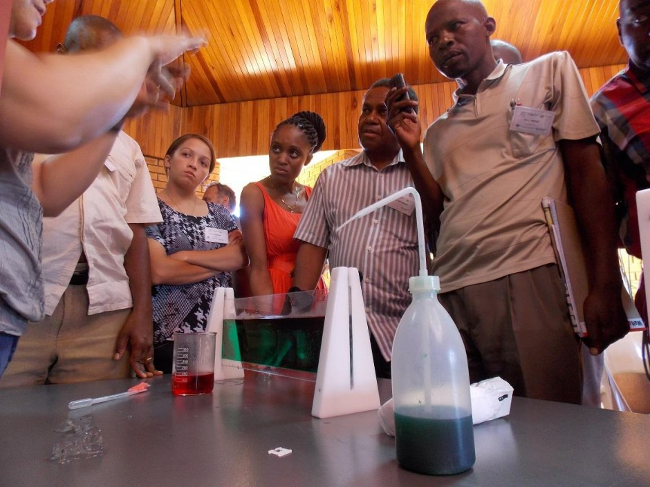 Sally Dengg explaining an experiment about thermohaline circulation to the teachers. For some of our practicals we had to improvise with materials commonly available to teachers – instead of test tubes we used plastic bottles. (Credit: Jane Robb)