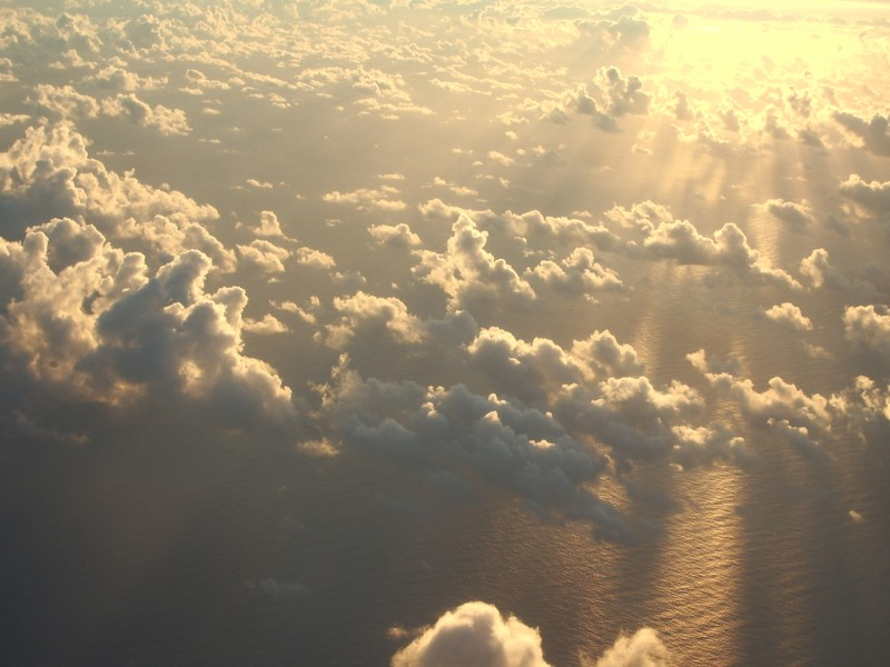 Shallow cumulus clouds at sunrise. (Credit: Jennifer Small via imaggeo.egu.eu)