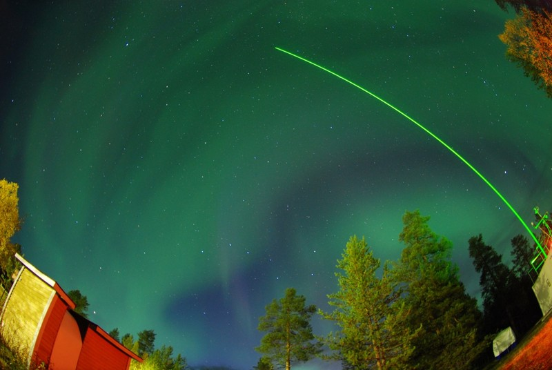 Laser and auroras. (Credit: Matias Takala distributed via imaggeo.egu.eu)
