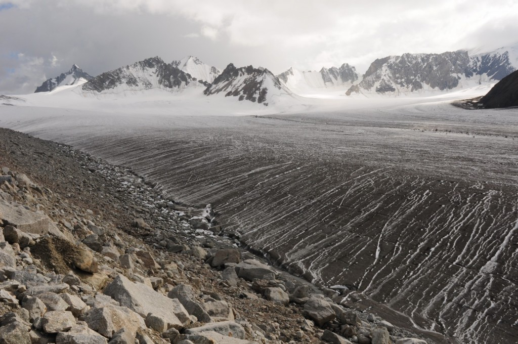 Black Abramov glacier. Before the fall of the Soviet Union, Abramov glacier provided one the the longest continuous glacier mass balance records, dating back to 1968. In 2011, a global research network re-established a monitoring program in cooperation with local partners. The picture highlights the important role of surface albedo in terms of glacier ablation. Credit: Leo Sold (distributed via imaggeo.egu.eu