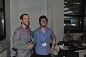 Sam Illingworth (on the left) handing over the batton of the ECS Community over to Wouter at EGU 2014. Image Credit: Roelof Rietbroek, ECS Representative for the EGU Geodesy Division.