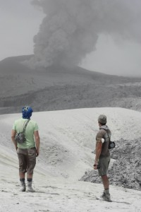Ian Schipper with Jon Castro watching the mouth of the volcano churning out volcanic ash. Image Credit: Dr. Hugh Tuffen