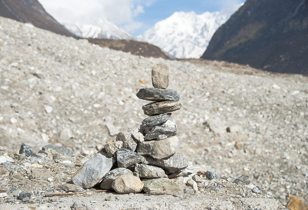 A pile of commemorating stones on the debris that buried Langtang and nearby villages last April, killing and leaving missing nearly 400 people. (Credit: Jane Qiu)
