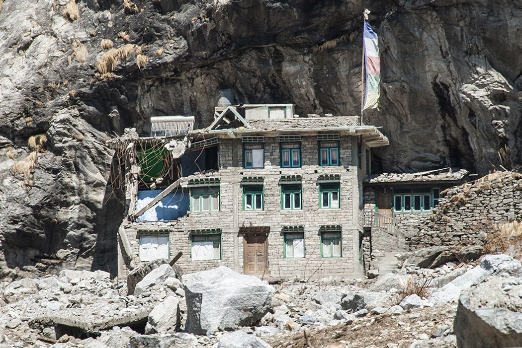 The only building in the village of Langtang that survived the avalanche. The rocky enclave protected it from the crushing debris and the powerful blast. (Credit: Jane Qiu)