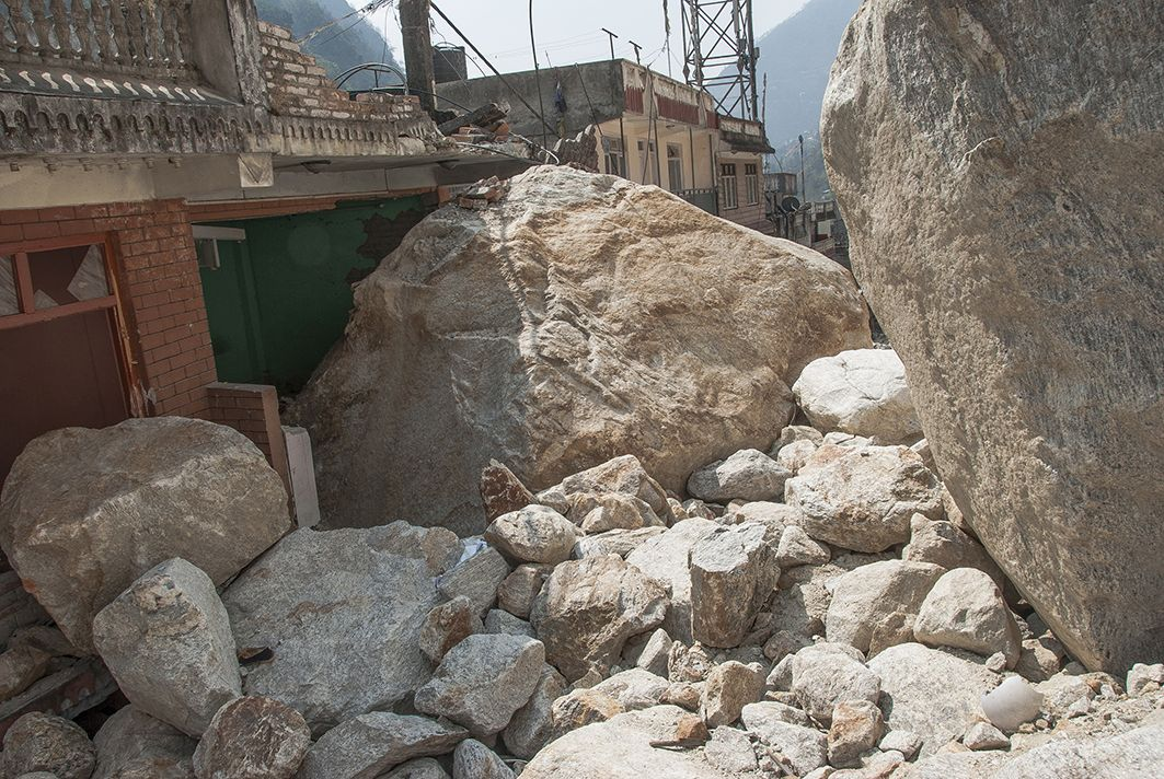 A building in Kodari — which used to be a bustling trade town at the Nepal-Tibet border — was unscathed during the earthquake only to be damaged by large rock falls. (Credit: Jane Qiu)