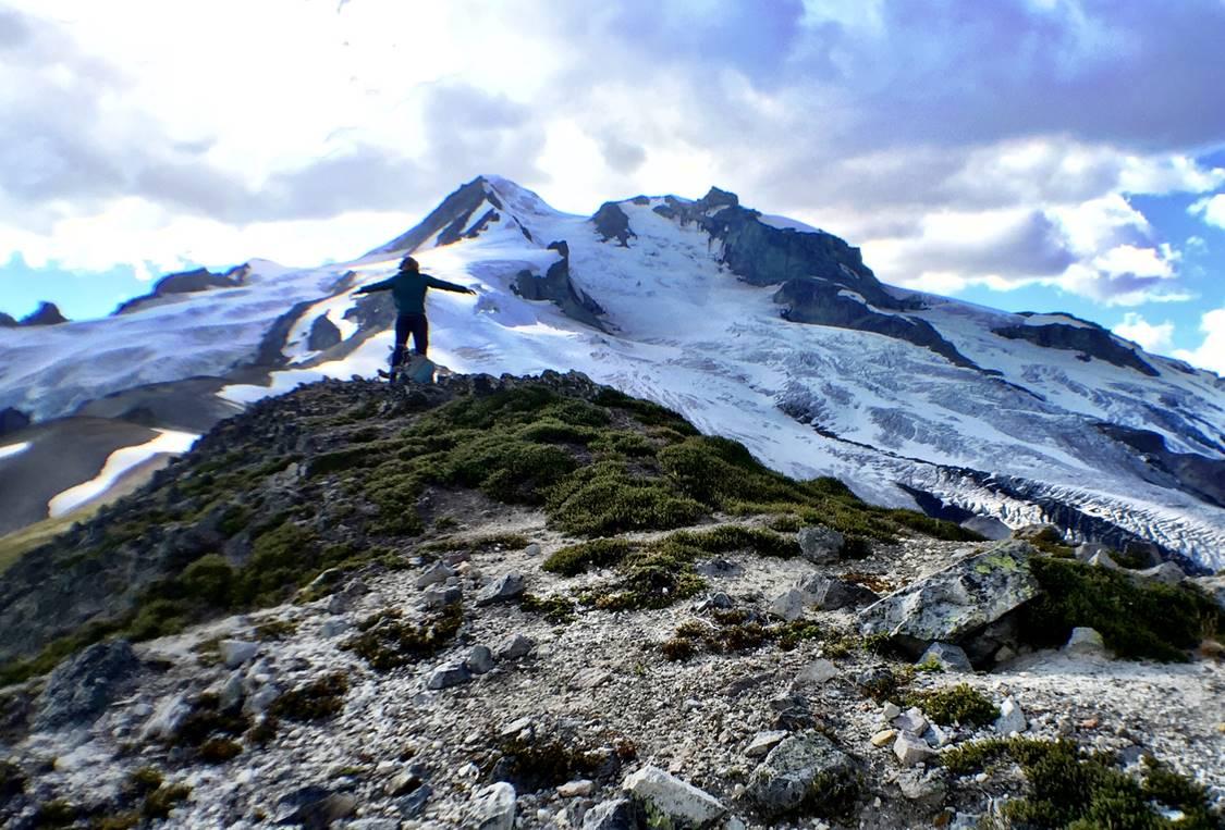 USGS summer intern Kristin Beck enjoying the view of Glacier Peak volcano from 7,000 ft. elevation. Credit: Alexa Van Eaton