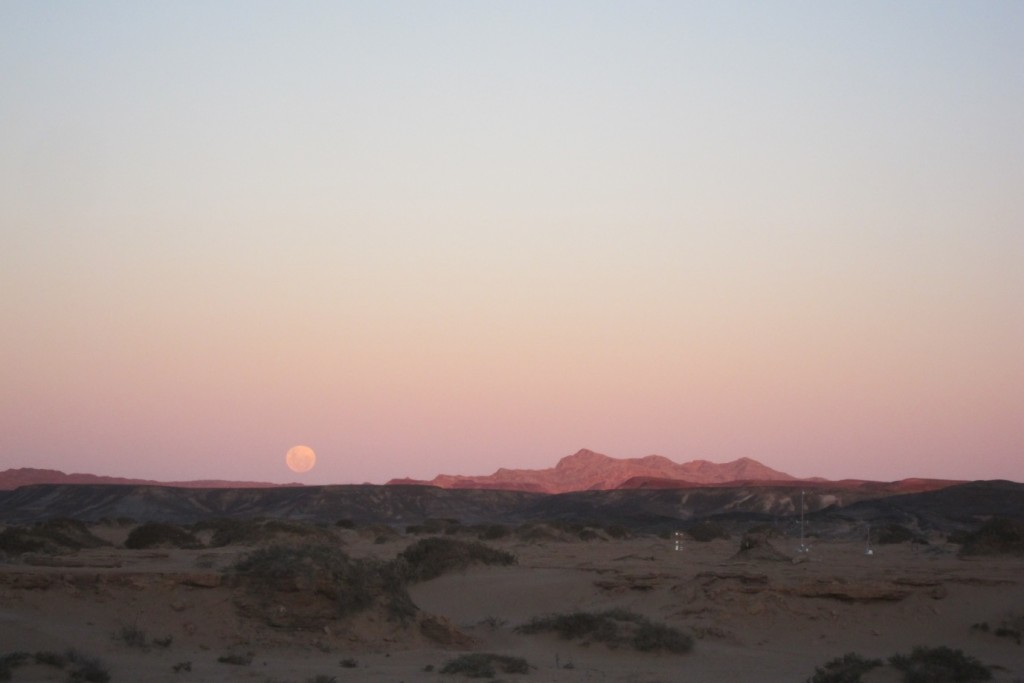The rising moon over one of the weather stations photographed from the campsite. (Credit: A. Dansie)