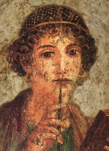 Detail of the portrait of a young woman with writing pen and wax tablets, Museo Archeologico Nazionale di Napoli - Source: Wikimedia Commons.