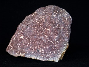 Porphyry, with large crystals visible in a finer surrounding - Source: Piotr Sosnowski, Wikimedia Commons.