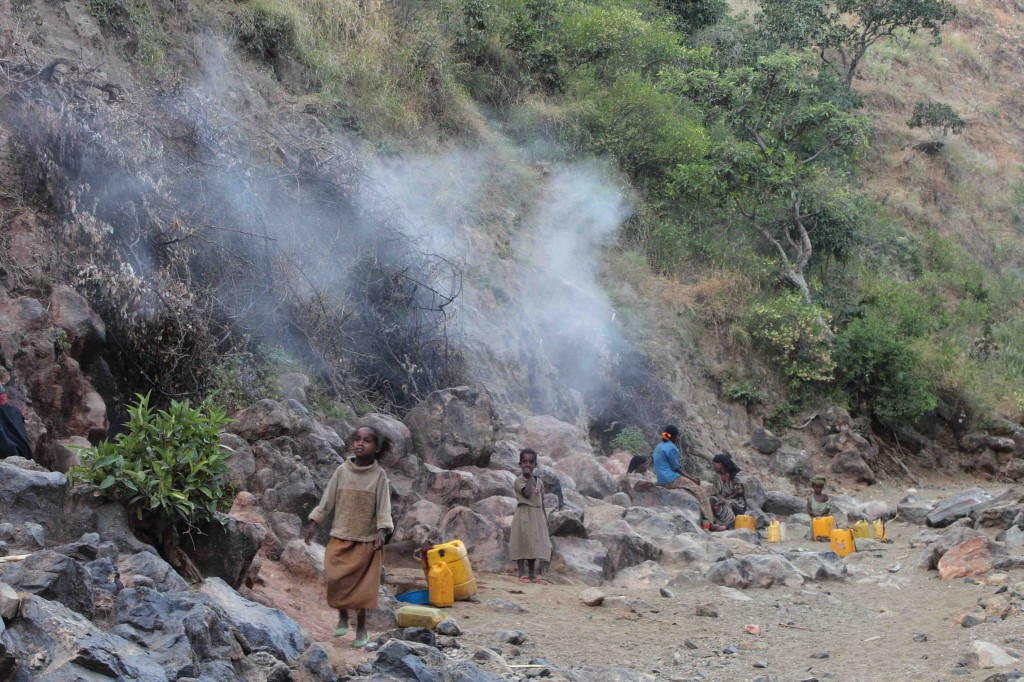 Steam emanating from volcanic rocks at Alutu volcano, Ethiopia. Locals condense the steam to provide drinking water Credit: Elspeth Robertson