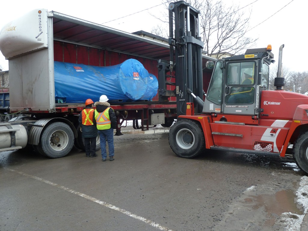 The accelerator portion in its shipping container being transferred into our new building. (Photo: Dr. Liam Kieser)