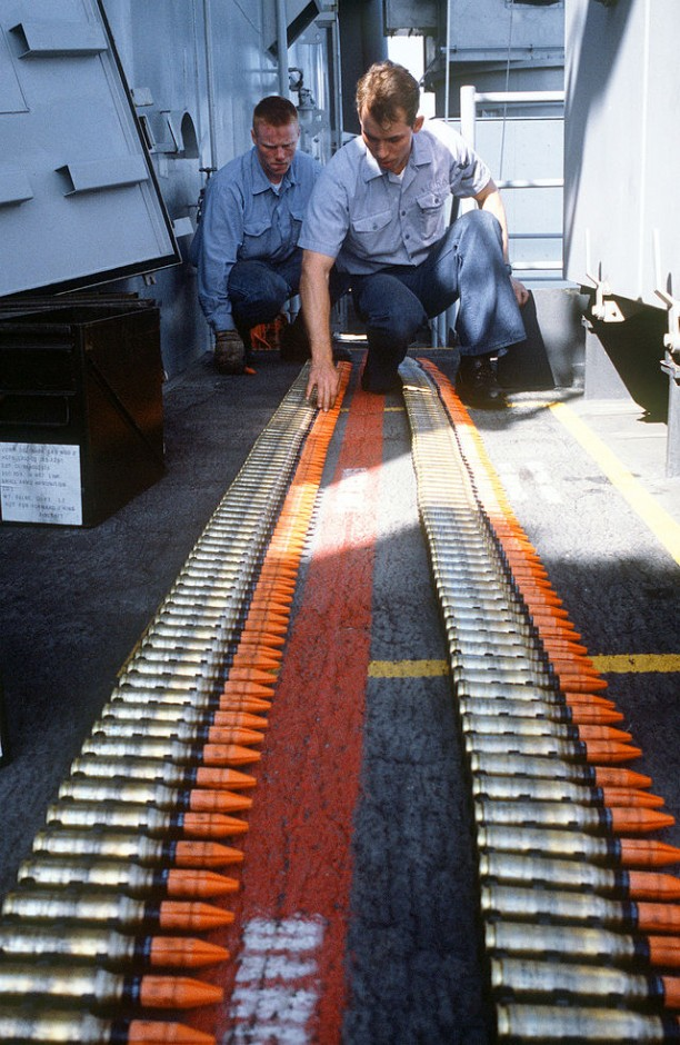 Gunner's mates inspect linked belts of Mark 149 Mod 2 20mm ammunition before loading it into the magazine of a Mark 16 Phalanx close-in weapons system aboard the battleship USS MISSOURI