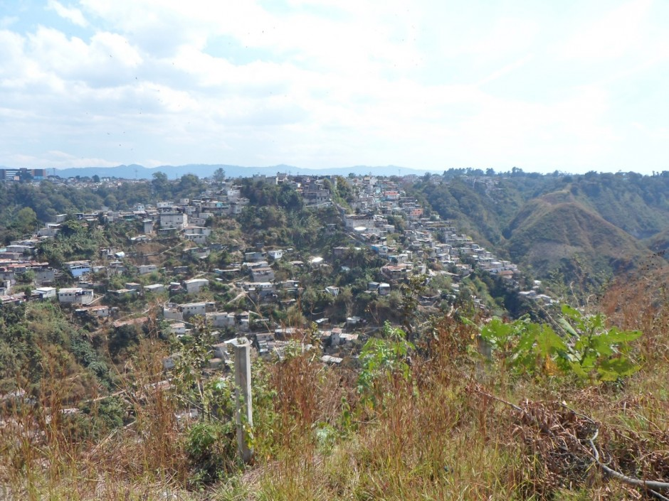 A community within Guatemala City, living on steep slopes vulnerable to landsliding.