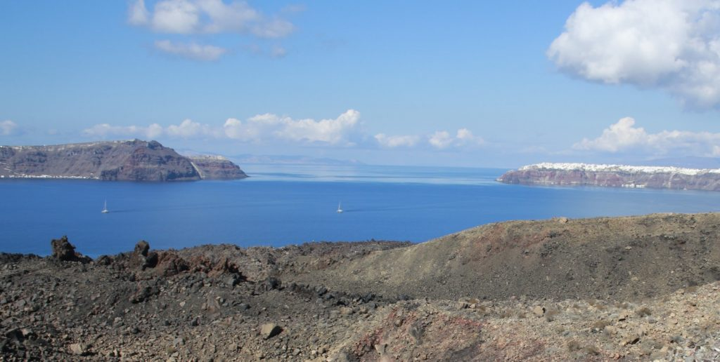 View, looking North, of the northern part of the Santorini caldera. The island of Thersia (left) is separated from the island of Thera (right) by a channel, that is now thought to have formed at the end of the Late Bronze Age eruption.